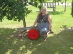 Cllr James with a wreath of remembrance by the Fazeley tree at the National Memorial Arboretum in Alrewas